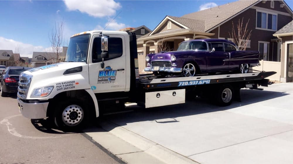 blue diamond towing of north parker truck with a classic purple car