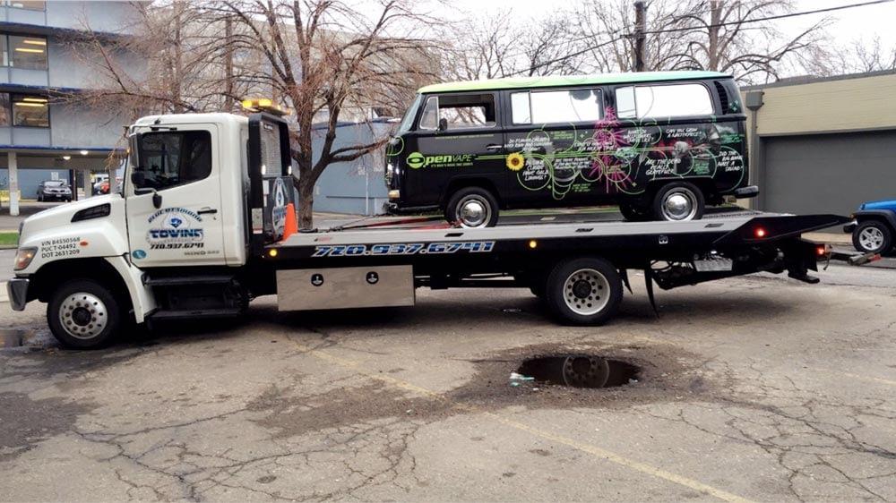 tow truck with VW van